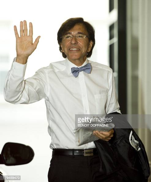 Belgian Prime Minister Elio Di Rupo gestures as he arrives for a kern meeting a restricted cabinet meeting focusing on the situation in Syria and the...