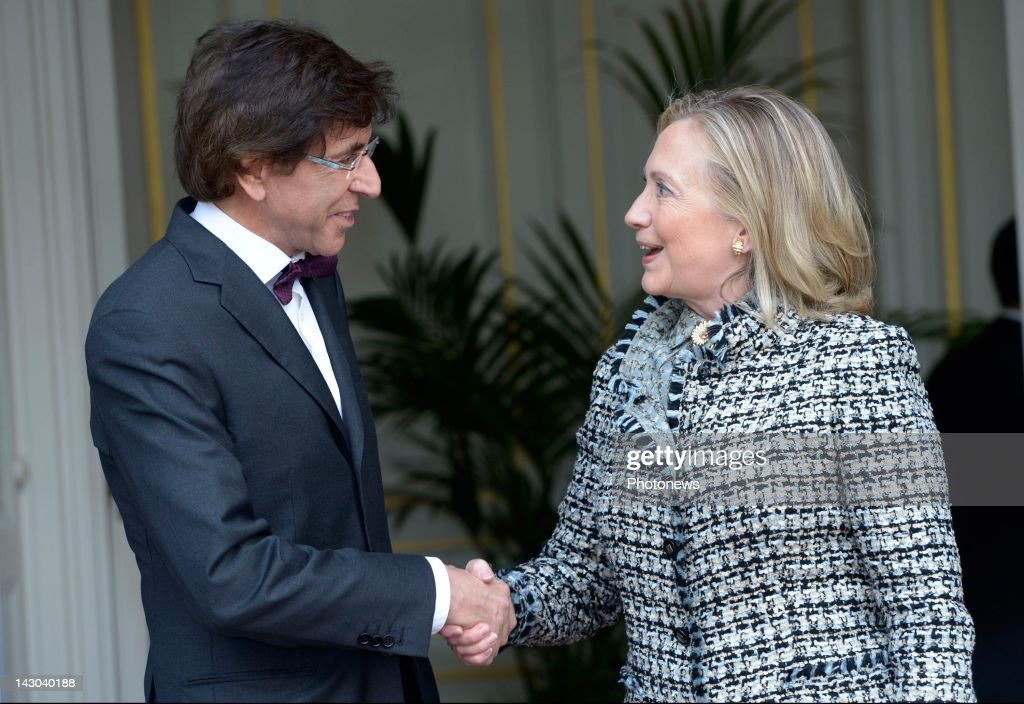 Belgian Prime Minister <a gi-track='captionPersonalityLinkClicked' href=/galleries/search?phrase=Elio+Di+Rupo&family=editorial&specificpeople=743705 ng-click='$event.stopPropagation()'>Elio Di Rupo</a> shakes hands with U.S. Secretary of State <a gi-track='captionPersonalityLinkClicked' href=/galleries/search?phrase=Hillary+Clinton&family=editorial&specificpeople=76480 ng-click='$event.stopPropagation()'>Hillary Clinton</a> (R) at the Prime Minister's Lambermont office on April 18, 2012 in Brussels, Belgium. <a gi-track='captionPersonalityLinkClicked' href=/galleries/search?phrase=Hillary+Clinton&family=editorial&specificpeople=76480 ng-click='$event.stopPropagation()'>Hillary Clinton</a> is in Brussels for a joint meeting of NATO foreign and defense ministers where discussions will focus on preparations for forthcoming NATO summit, to be held in Chicago in May.