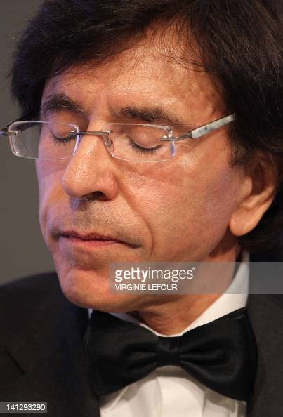 Belgian Prime Minister Elio Di Rupo sits during a press conference after a meeting of the Kern restricted minister's council in Brussels on March 14...