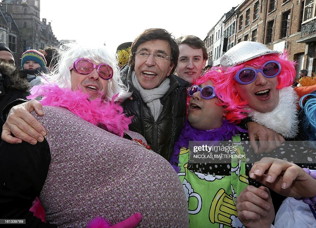 Belgian Prime Minister Elio Di Rupo (C) takes part in the carnival on February 10, 2013 in the streets of Binche. The Binche Carnival tradition is one of the most ancient and representative of Wallonia and inscribed in 2008 on the Representative List of the Intangible Cultural Heritage of Humanity by UNESCO. AFP PHOTO / BELGA / NICOLAS MAETERLINCK