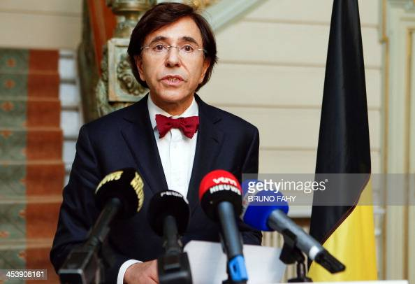 Belgian Prime Minister Elio Di Rupo talks to the press on December 6 2013 a day after the passing of former South African President Nelson Mandela...