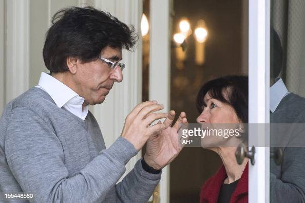 Belgian Prime Minister Elio Di Rupo talks with VicePrime Minister and Minister of Social Affairs and Public Health Laurette Onkelinx at the start of...