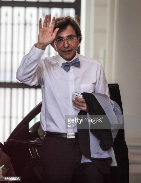 Belgian Prime Minister Elio Di Rupo waves as he arrives at the Prime Minister's office for a Kern meeting a restricted ministers meeting at the 16...