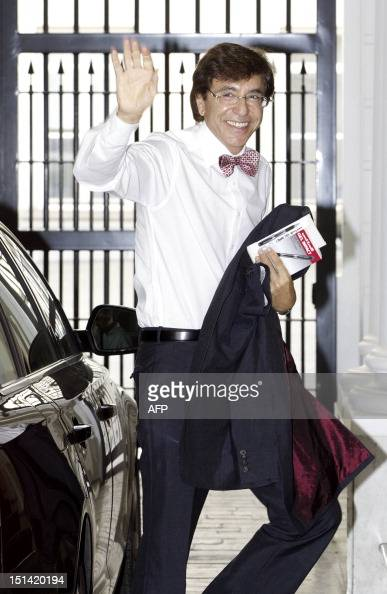 Belgian Prime Minister Elio Di Rupo waves as he arrives for a ministers council meeting at the Prime Minister's office on September 7 2012 in...