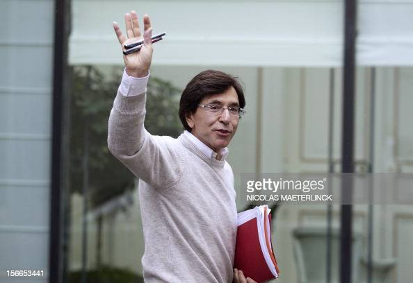 Belgian Prime Minister Elio Di Rupo waves as he arrives for a kern meeting a restricted ministers budget meeting at the Prime Minister's residence on...