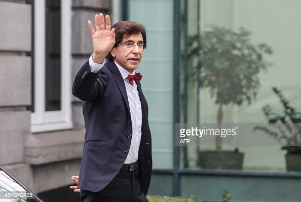 Belgian Prime Minister Elio Di Rupo waves as he arrives for a Kern meeting a restricted ministers meeting in Brussels on December 17 2013 AFP...