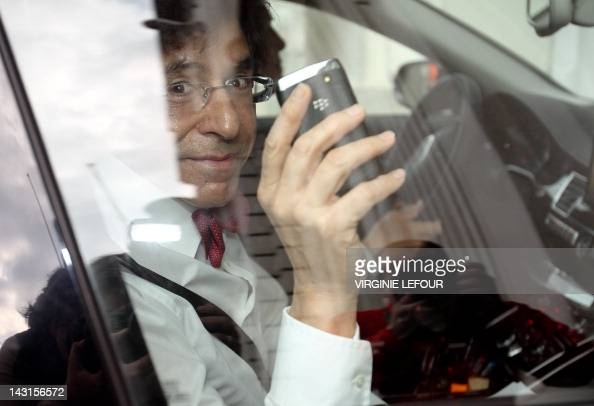 Belgian Prime Minister Elio Di Rupo with his smartphone in his hands arrives at the Prime Minister's office for a kern meeting a restricted ministers...
