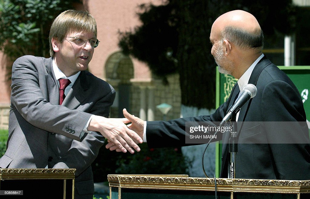 Belgian Prime Minister Guy Verhofstadt (L) shakes hands with Afghan President Hamid Karzai (R) at the Presidential Palace in Kabul, 20 May 2004. Verhofstadt is in Kabul for one day to visit Karzai and to meet with officials from the NATO-led International Security Assistance Force (ISAF) of peacekeeping troops to which Belgium contributes some 290 troops. Belgium's ISAF contingent are mostly are deployed providing security at Kabul International Airport. Command of ISAF will be taken over from Canada by Eurocorps in August 2004,with Belgium expected to be among the major contributors to the force. AFP PHOTO/ SHAH Marai