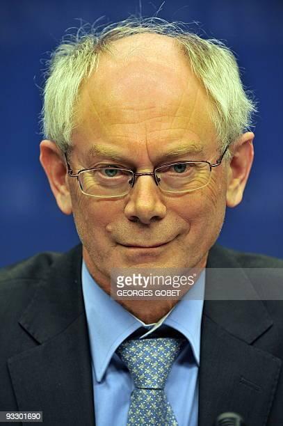 Belgian Prime Minister Herman Van Rompuy chosen as the new EU president smiles during a presser at the European Council headquarters on November 19...