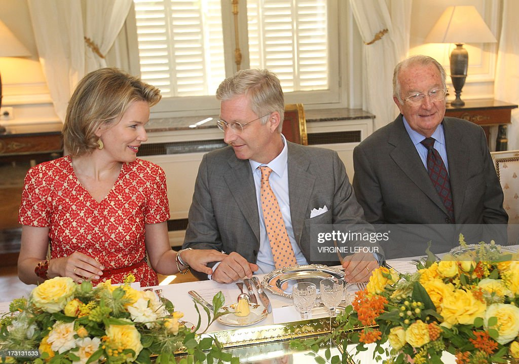 Belgian Princess Mathilde (L), Crown Prince Philippe and King Albert II attend on July 8, 2013 a reception at the royal castle in Laeken - Laken in Brussels for members of the committee for institutional reforms. Prince Philippe said on July 4 he was 'well aware' of the responsibilities of his new role in light of the announcement that his father Albert II would abdicate in his favor on July 21, Belgium's national holiday.