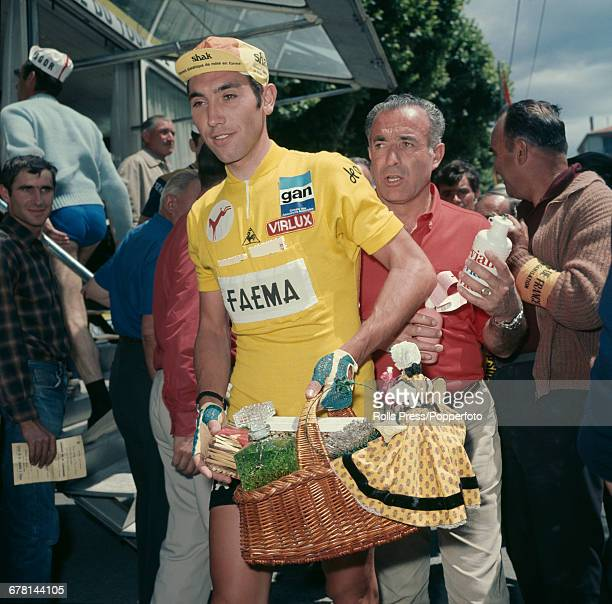 Belgian professional road race cyclist Eddy Merckx pictured holding a basket of gifts after finishing in first place after the final time trial stage...