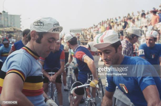 Belgian professional road race cyclist Eddy Merckx pictured on left talking to Italian racing cyclist Felice Gimondi prior to competing in the Men's...