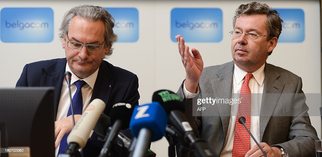 Belgian Public Enterprises and Development Cooperation Minister Jean-Pascal Labille (L) and the chief executive officer of Belgium state-owned telephone operator Belgacom, <a gi-track='captionPersonalityLinkClicked' href=/galleries/search?phrase=Didier+Bellens&family=editorial&specificpeople=878481 ng-click='$event.stopPropagation()'>Didier Bellens</a> (R), give a press conference on September 16, 2013 at company headquarters in Brussels about the digital burglary into Belgacom's computer systems. Belgacom said on September 16 that its network had suffered an 'intrusion' which a Belgian media report blamed on the US National Security Agency as it snooped on communications in Africa and the Middle East. Federal prosecutors said on September 16 that Belgacom had filed a complaint in July for 'non-authorized access' to its servers. OUT -
