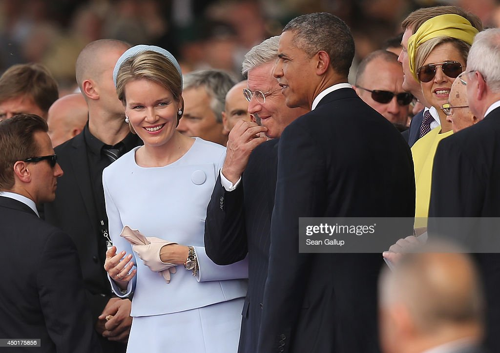 Belgian Queen Mathilde smiles at U.S. President <a gi-track='captionPersonalityLinkClicked' href=/galleries/search?phrase=Barack+Obama&family=editorial&specificpeople=203260 ng-click='$event.stopPropagation()'>Barack Obama</a> at the main international ceremony with 17 heads of state at Sword Beach on June 6, 2014 at Ouistreham, France. Friday the 6th of June is the 70th anniversary of the D-Day landings that saw 156,000 troops from the Allied countries, including the United Kingdom and the United States, join forces to launch an audacious attack on the beaches of Normandy, these assaults are credited with the eventual defeat of Nazi Germany. A series of events commemorating the 70th anniversary are planned for the week with many heads of state travelling to the famous beaches to pay their respects to those who lost their lives.
