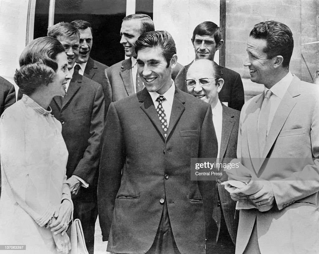 Belgian racing cyclist Eddy Merckx (centre) at the Royal Castle of Laeken, Brussels, with King Baudouin I (1930 - 1993, right) and Queen Fabiola after Merckx won the Tour de France, 23rd July 1969.