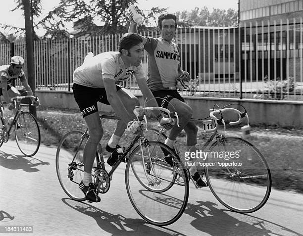 Belgian racing cyclist Eddy Merckx is doused with water by a fellow rider during the Saint Vincent to Milan stage of he Giro d'Italia 24th May 1973...