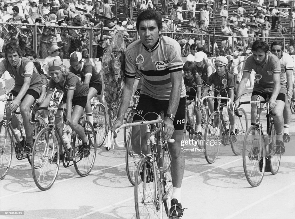Belgian racing cyclist <a gi-track='captionPersonalityLinkClicked' href=/galleries/search?phrase=Eddy+Merckx&family=editorial&specificpeople=213957 ng-click='$event.stopPropagation()'>Eddy Merckx</a>, with junior cyclists at a Grand Fete held at the Heysel Stadium (now King Baudouin Stadium) in Brussels, Belgium, 29th June 1976.
