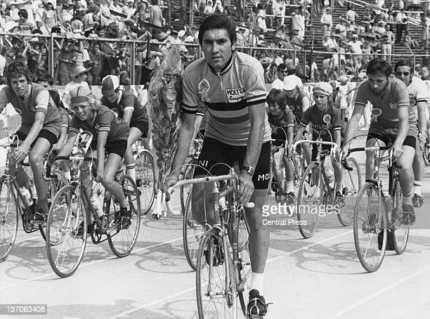 Belgian racing cyclist Eddy Merckx with junior cyclists at a Grand Fete held at the Heysel Stadium in Brussels Belgium 29th June 1976