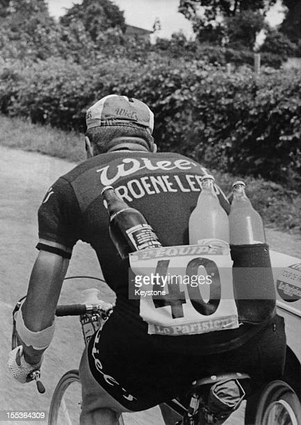 Belgian racing cyclist Rene Van Meenen carrying refreshments during the 16th stage of the Tour de France between Grenoble and Vald'Isere 9th July 1963