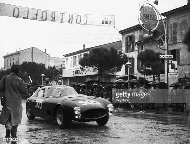 Belgian racing driver Olivier Gendebien and codriver/navigator Phillip Washer pass through Ravenna during the Mille Miglia in their Ferrari 250 GT...