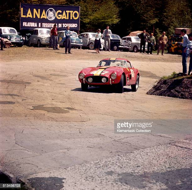 Belgian racing driver Olivier Gendebien rounds a tight corner on the way up the Futa Pass in his Ferrari 250 GT Berlinetta 'Tour de France' during...