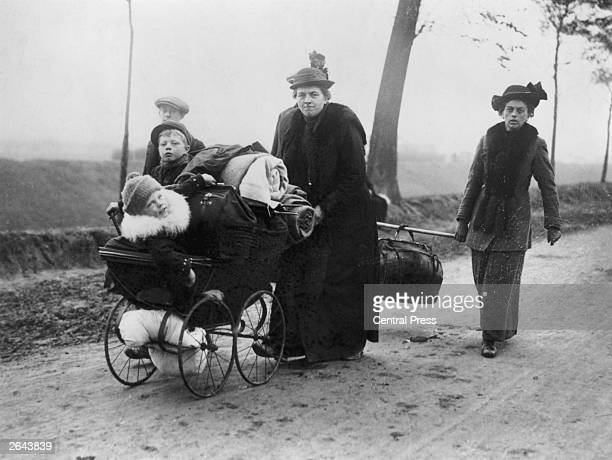 Belgian refugees carry their belongings ahead of the invading troops through Northern France