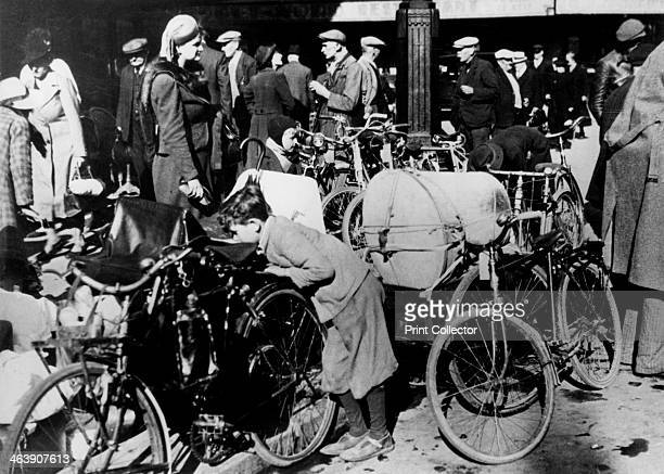 Belgian refugees with their bicycles and possessions outside the Gare du Nord Paris July 1940 Belgians who had fled to France ahead of the German...