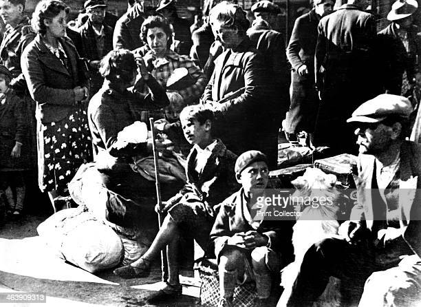 Belgian refugees with their possessions outside the Gare du Nord Paris July 1940 Belgians who had fled to France ahead of the German invasion...