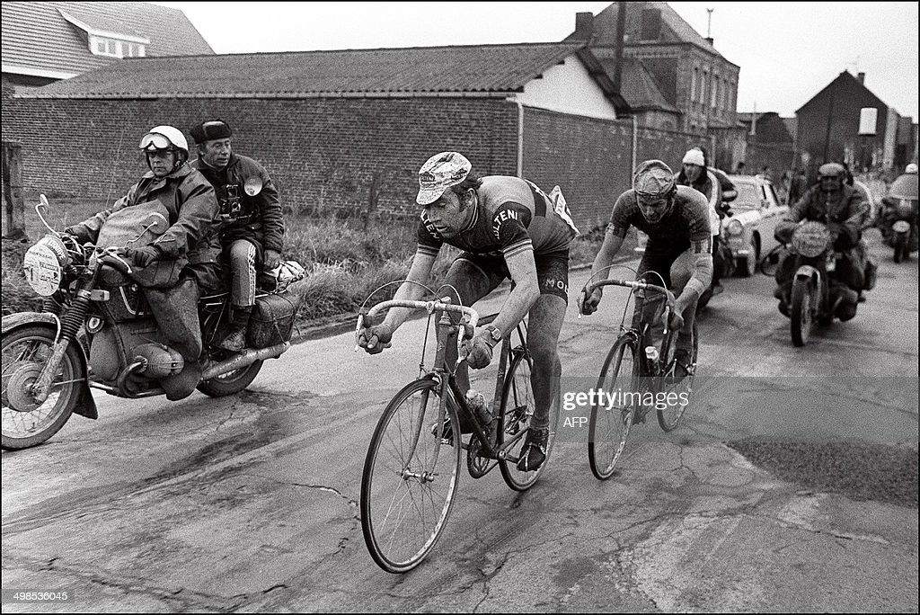 Belgian rider <a gi-track='captionPersonalityLinkClicked' href=/galleries/search?phrase=Eddy+Merckx&family=editorial&specificpeople=213957 ng-click='$event.stopPropagation()'>Eddy Merckx</a> is closely followed by his compatriot Roger De Vlaeminck, on April 15, 1973 during the 71st race between Paris-Roubaix.