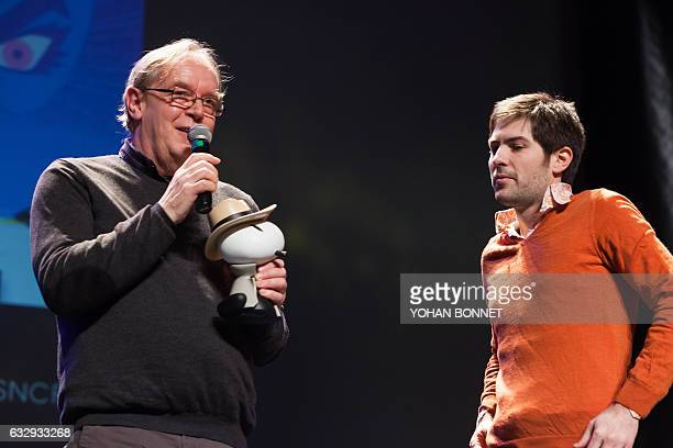 Belgian scenario writer Thierry Smolderen and French cartoonist Alexandre Clerisse react after receiving the SNCF detective novel prize for their...