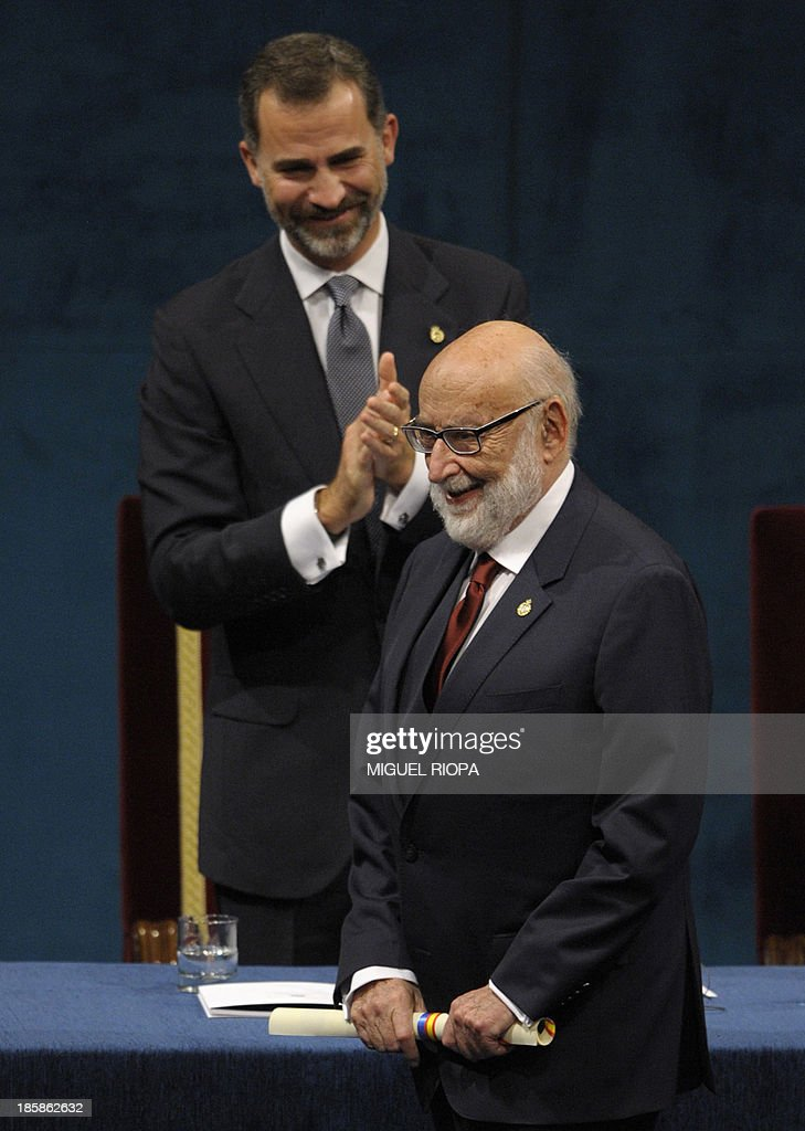 Belgian scientist Francois Englert (R) celebrates on the stage after receiving the 2013 Prince of Asturias Award for Technical & Scientific Research from Spain's Prince Felipe during the Prince of Asturias awards ceremony in Oviedo, on October 25, 2013.