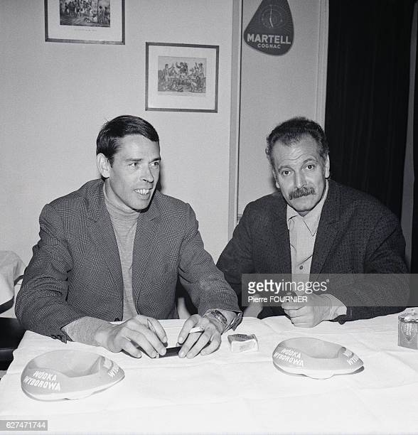 Belgian singer and songwriter Jacques Brel sits at a table with French singer and songwriter Georges Brassens Brel enjoyed great popularity in France...