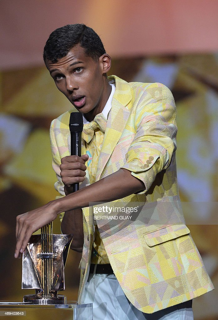 Belgian singer Paul Van Haver, aka Stromae, delivers a speech after receiving the men's artist of the year award during the 29th Victoires de la Musique, the annual French music awards ceremony, on February 14, 2014 at the Zenith concert hall in Paris.