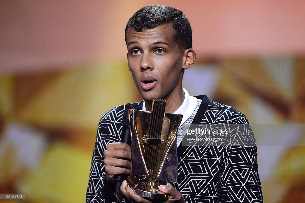 Belgian singer Paul Van Haver, aka Stromae, delivers a speech after receiving the best music video of the year award for his song 'Formidable' during the 29th Victoires de la Musique, the annual French music awards ceremony, on February 14, 2014 at the Zenith concert hall in Paris. AFP PHOTO / BERTRAND GUAY