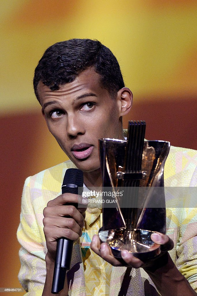 Belgian singer Paul Van Haver, aka Stromae, delivers a speech after receiving the best album of the year award for his album 'Racine Caree' during the 29th Victoires de la Musique, the annual French music awards ceremony, on February 14, 2014 at the Zenith concert hall in Paris.