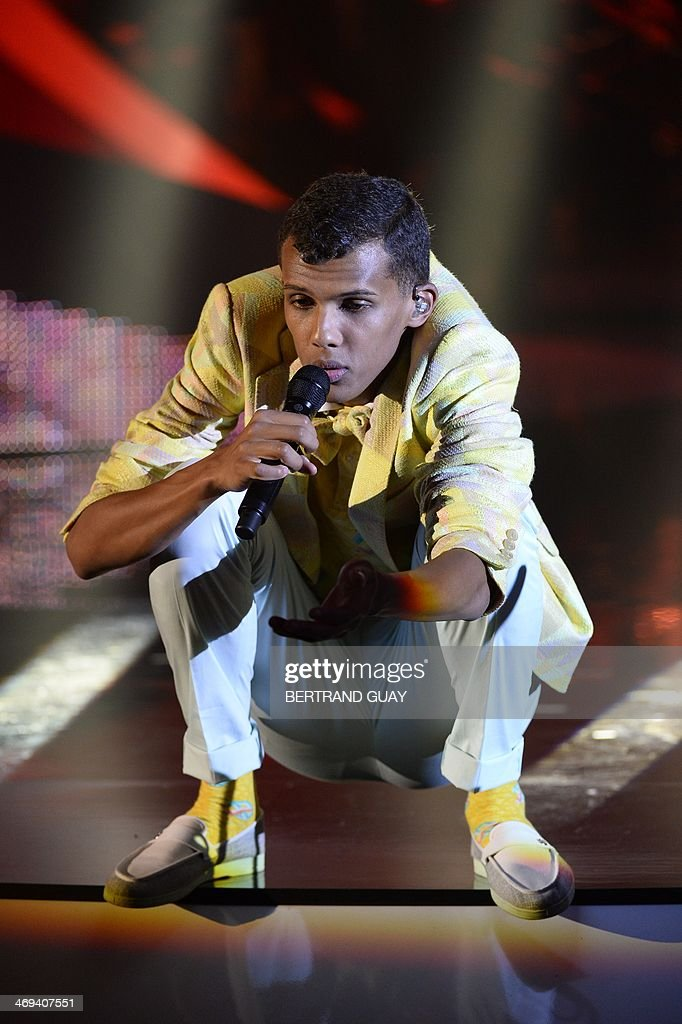 Belgian singer Paul Van Haver, aka Stromae, performs on stage during the 29th Victoires de la Musique, the annual French music awards ceremony, on February 14, 2014 at the Zenith concert hall in Paris. AFP PHOTO / BERTRAND GUAY