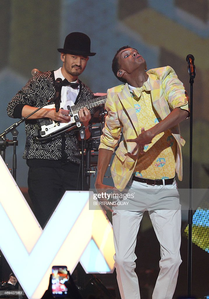 Belgian singer Paul Van Haver (R), aka Stromae, performs on stage during the 29th Victoires de la Musique, the annual French music awards ceremony, on February 14, 2014 at the Zenith concert hall in Paris.