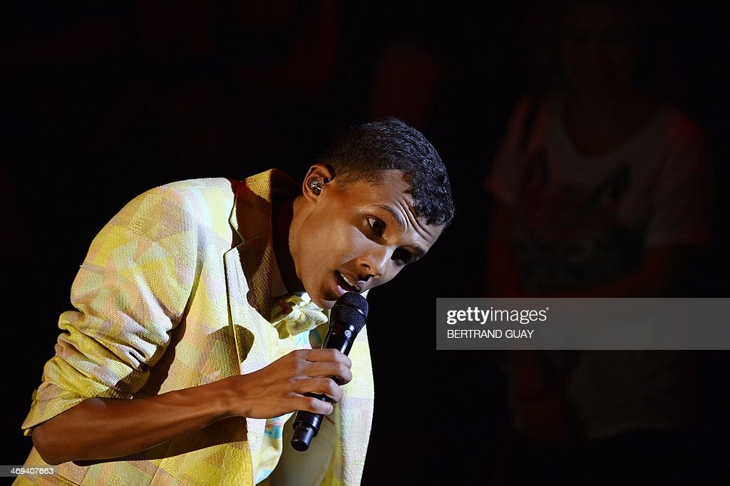 Belgian singer Paul Van Haver, aka Stromae, performs on stage during the 29th Victoires de la Musique, the annual French music awards ceremony, on February 14, 2014 at the Zenith concert hall in Paris.