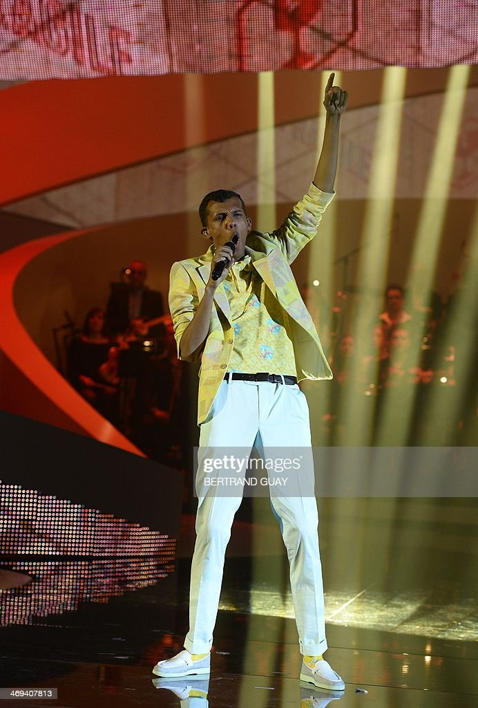 Belgian singer Paul Van Haver (C), aka Stromae, performs on stage during the 29th Victoires de la Musique, the annual French music awards ceremony, on February 14, 2014 at the Zenith concert hall in Paris.