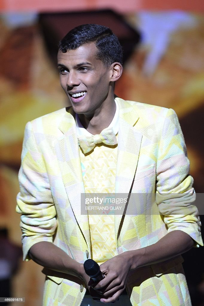 Belgian singer Paul Van Haver, aka Stromae, reacts at the opening of the 29th Victoires de la Musique, the annual French music awards ceremony, on February 14, 2014 at the Zenith concert hall in Paris. AFP PHOTO / BERTRAND GUAY