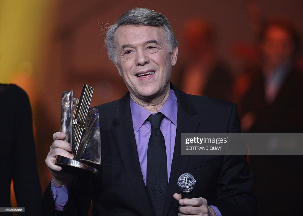 Belgian singer Salvatore Adamo delivers a speech after receiving an honorary award for his life time achievement during the 29th Victoires de la Musique, the annual French music awards ceremony, on February 14, 2014 at the Zenith concert hall in Paris.