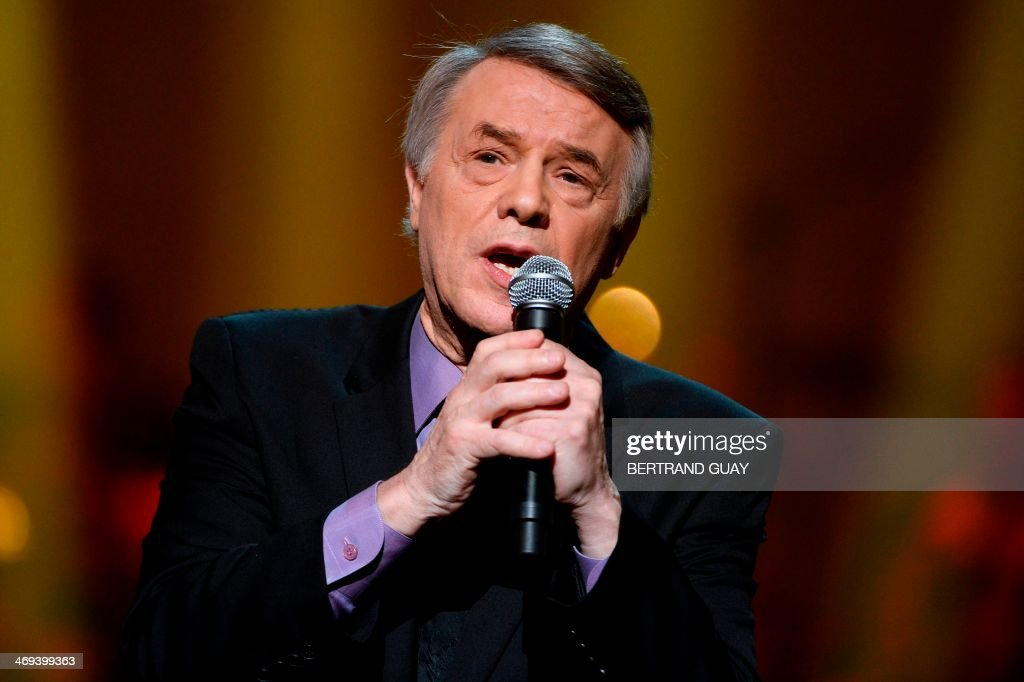 Belgian singer Salvatore Adamo performs during the 29th Victoires de la Musique, the annual French music awards ceremony, on February 14, 2014 at the Zenith concert hall in Paris. AFP PHOTO / BERTRAND GUAY