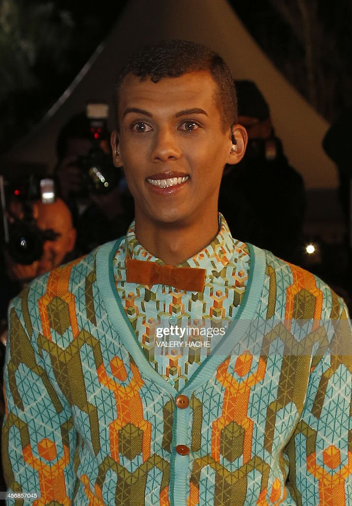 Belgian singer Stromae arrives at the Palais des Festivals to attend the 15th Annual NRJ Music Awards on December 14, 2013 in Cannes, southeastern France.