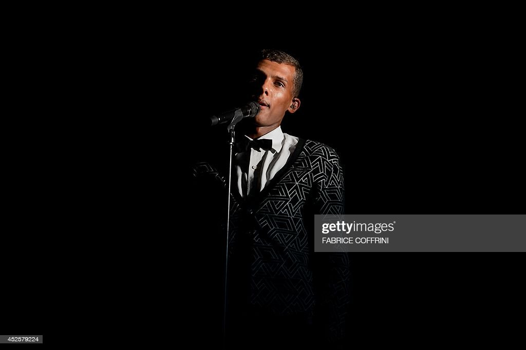 Belgian singer Stromae performs at the 39th Paleo Festival Nyon on July 23, 2014 in Nyon. With six days of festivities, 230,000 spectators were expected to attend some 250 performances at Paleo Festival Nyon, one of Europes major musical events.