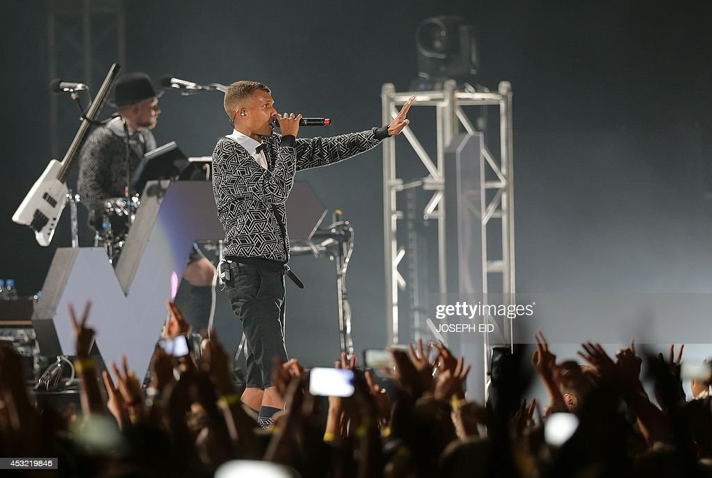 Belgian singer-songwriter Paul Van Haver better known by his stage name Stromae, performs during the Byblos International Festival, north of the Lebanese capital Beirut, on August 5, 2014.