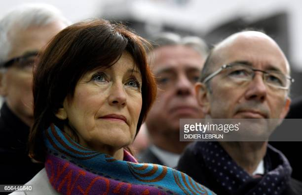 Belgian Socialist Party member Laurette Onkelinx and Federation Wallonia Brussels Minister President Rudy Demotte stand during a minute of silence at...