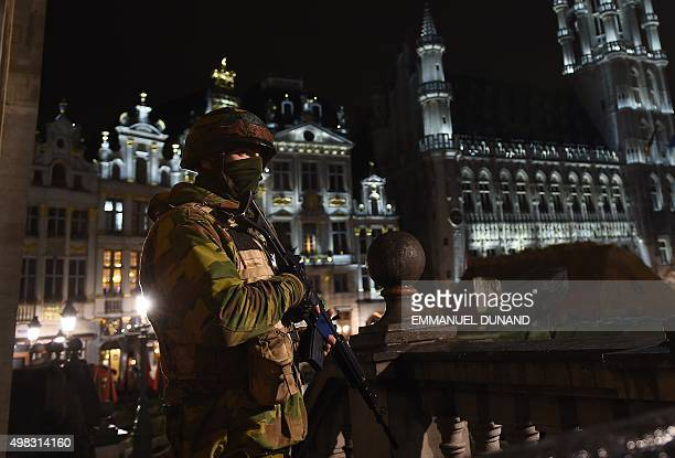 A Belgian soldier stands guard around a security perimeter as a reported police intervention takes place around the Grand Place central square in...