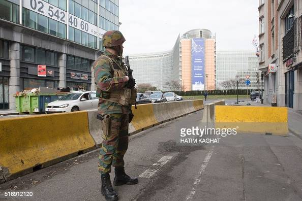 A Belgian soldier stands guard at the Berlaymont building in Brussels the headquarters of the European Commission on March 22 2016 near the Maalbeek...