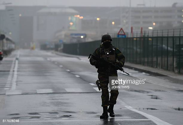 A Belgian soldier stands guard near Brussels airport in Zaventem on March 23 2016 a day after terror attacks hit the city Belgian investigators were...