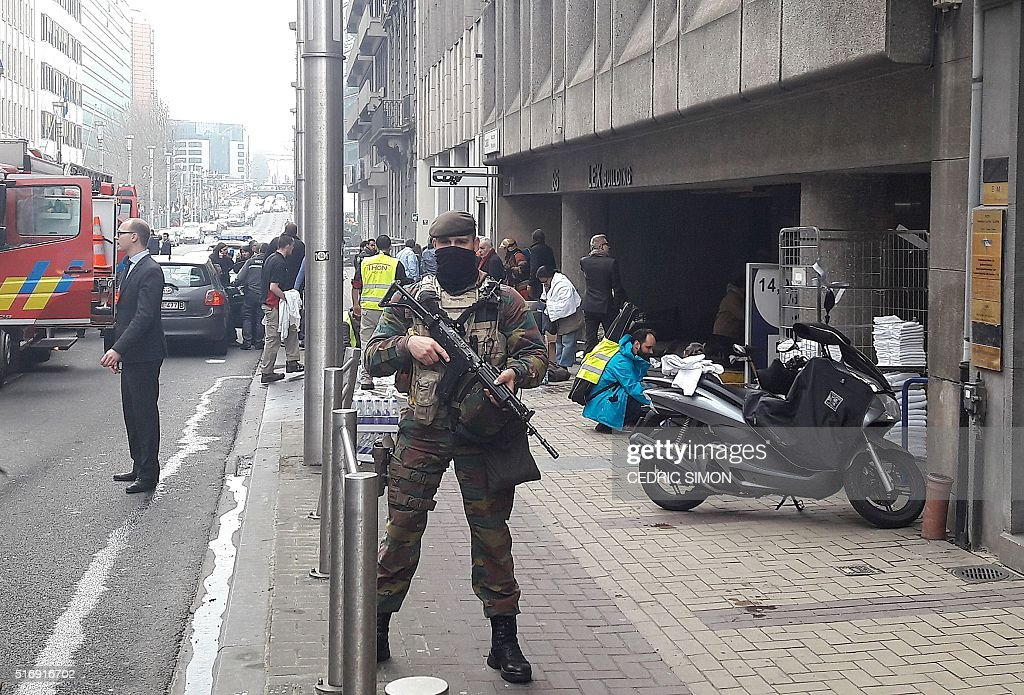 A Belgian soldier stands guard outside the Maalbeek Maelbeek metro station in Brussels on March 22 2016 after a blast at this station located near...